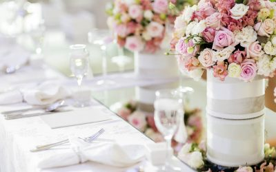 Beautiful wedding decoration with roses and a luxurious table setting